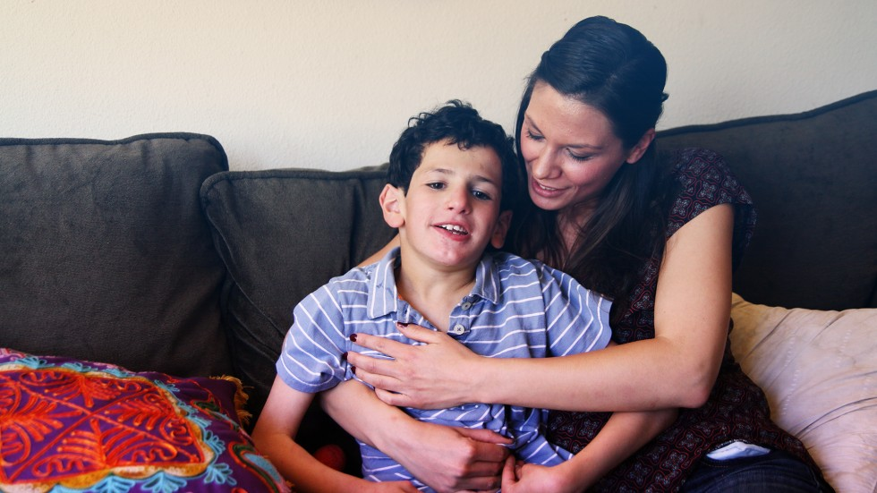 Professional au pair occupational therapist with child with severe special needs