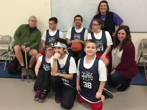 Garoa from Spain (purple sweater) volunteers with her host children's basketball team.
