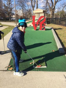 Sam playing mini golf in Philadelphia.